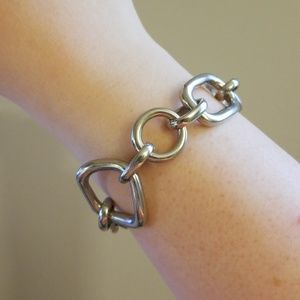 Silver chain shapes bracelet